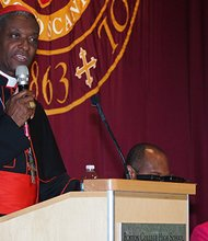 Newly-ordained Cardinal Chibly Langlois speaks during a fundraiser Sunday at Boston College High School.