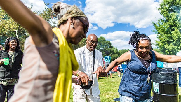 (l-r) Wyoma, Menelik Musa and Sheryl Royster dance during the sunny saturday afternoon at the Roxbury Pride Day/Juneteenth Celebration.