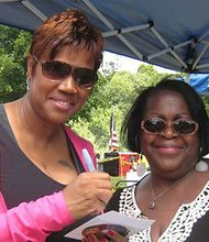 Singer Margo Thunder (l) signs an autograph for Karen Williams during the Roxbury Pride Day/Juneteenth celebration at Franklin Park.
