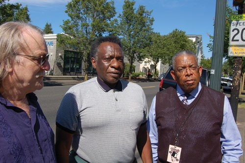 Bob Zyback (left) and Mike Grice (right), two longtime Portland educators looking to resurrect a student-led study on the heavily gentrified neighborhoods around Northeast Alberta Street, visit with Nate Hartley of Hartley Oil Co., one of the few black business owners who still operate on the thoroughfare synonymous with gentrification.