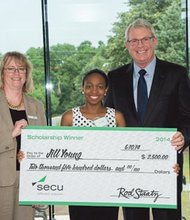 Baltimore resident Jill Young recently won a $2,500 scholarship as part of SECU's annual State Employee Scholarship program. Young, who is attending the University of Maryland School of Dentistry with Peggy Young (left), Vice President of Marketing at SECU, and Rod Staatz (right), President and CEO of SECU.