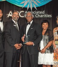 Michael E. Cryor, Chair of the University of Maryland School of Medicine (UM SOM) Board of Visitors, accepts his Icon Award during the Associated Black Charities 2014 Annual Gala in Baltimore. As well as being the Chair of the Board of Visitors for UM SOM, Mr. Cryor is also President of The Cryor Group, LLC. (Left to right) Honorary ABC Gala Co-chairman Wes Moore; ABC Board Chair Boyer Freeman; Michael Cryor; and ABC Board members Chineta Davis and Karen Banfield Evans.