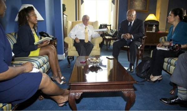 Democratic Reps. Steny Hoyer of Maryland (third from left) and John Lewis of Georgia (third from right) speak with reporters in the office of the House Minority Whip in D.C. on June 26, 2014.