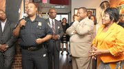 Boston Police Superintendent-in-Chief William Gross speaks while (l-r) Darryl Settles, Darnell Williams, Steve Tompkins and state Rep. Gloria Fox listen.