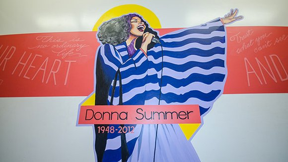 Muralists pay tribute to Dorchester native and disco superstar Donna Summer at the Jeremiah E. Burke High School