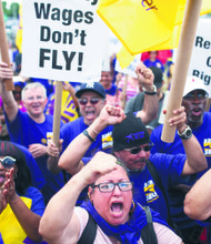 Airport workers rally