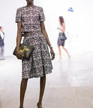 Top model and author Alek Wek in an H&M dress set with handbag.