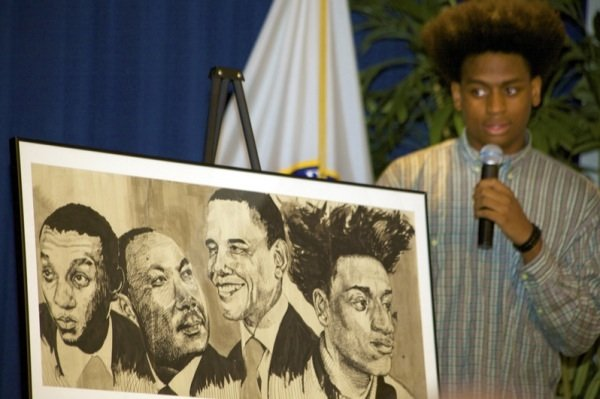 "Alfred Dudley III, NAACP ACT-SO winner, describes his ink drawing ""Black Rushmore"" during a June 2 ceremony at a U.S. Department of Education facility in Richmond, Virginia, to commemorate the 50th anniversary of the Civil Rights Act."