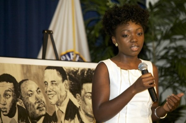 """Blossom Ojukwu, NAACP ACT-SO winner, sings """"We Shall Overcome"""" during a June 2 ceremony at a U.S. Department of Education facility in Richmond, Virginia, to commemorate the 50th anniversary of the Civil Rights Act."""