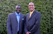 Lamin Jatta, president of the Kunta Kinteh Family Foundation and his cousin Chris Haley.