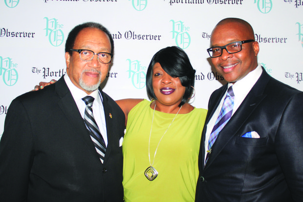 NNPA President Dr. Benjamin Chavis (from left) visits The Portland Observer backdrop at the Black Press national conference in Portland with Tamara Weston, Manager, Multicultural Marketing - Media for Macy's Marketing and Robert D. Bush, Senior Vice president of Sales and Marketing for the San Diego Voice & Viewpoint.