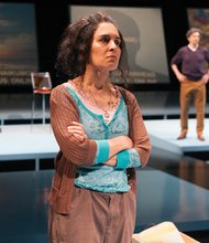 Odessa (Vilma Silva) monitors the conversation in her online chat room in 'Water By the Spoonful.' The Oregon Shakespeare Festival play delves in the sometimes messy and sometimes beautiful connections that make family relationships. Also features (from left) Celeste Den, Barret O'Brien and Bruce A. Young.