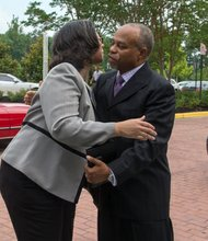 Pastor John K. Jenkins greets Sheila Curry during the funeral of her husband, The Honorable Wayne K. Curry at First Baptist Church of Glenarden on Thursday, July 10.