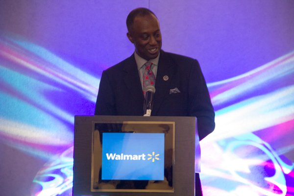 U.S. Black Chambers, Inc. President & CEO Ron Busby speaks during the School of Chamber and Business Management luncheon at the new Black-owned Marriott Marquis in Northwest on Thursday, July 10.