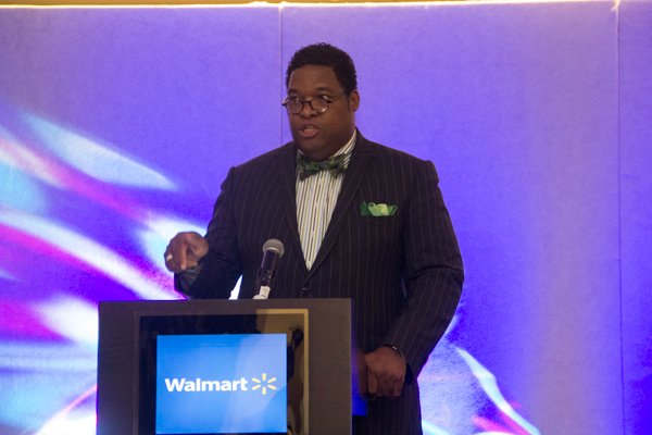 Walmart Senior Director of Corporate Affairs Constituent Relations speak during the School of Chamber and Business Management luncheon at the new Black-owned Marriott Marquis in Northwest on Thursday, July 10.
