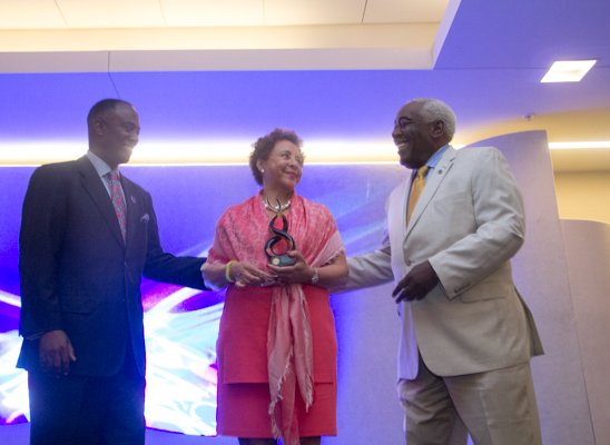 Ron Busby (left), U.S. Black Chambers, Inc. president & CEO and Aubrey Stone, chairman, president & CEO of the California Black Chamber of Commerce present an award to keynote speaker Sheila C. Johnson during the U.S. Black Chambers School of Chamber and Business Management luncheon held at the new Black-owned Marriott Marquis in Northwest on Thursday, July 10.
