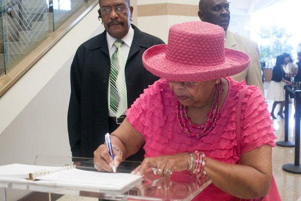 Anna Crutchfield, 88, signs the guest book before funeral services for the Honorable Wayne K. Curry at First Baptist Church of Glenarden on Thursday, July 10.