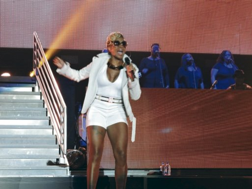 Mary J. Blidge in a white short set performing at Saturday night at the Superdome for the Essence Music Festival in New Orleans.