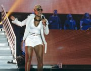 Mary J. Blige in a white short set performing Saturday night at the Superdome for the 