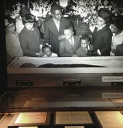 New civil and human rights center opens in Atlanta: Dr. Martin Luther King Jr. in his casket, surrounded by his family
