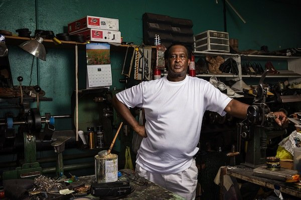 Dewitt Kimbley, 64, was born and raised in Greenwood, Miss., and runs a shoe repair business in the struggling downtown. (Edmund D. Fountain, special to ProPublica)