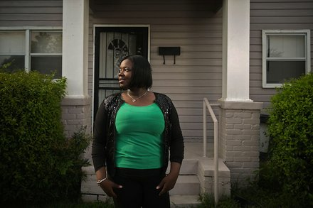 Evonna Lucas stands for a portrait outside of her home on in south Greenwood. Lucas graduated from Mississippi Valley State University last year, but said that well-paying jobs for educated young people are hard to find in her hometown. (Edmund D. Fountain, special to ProPublica)