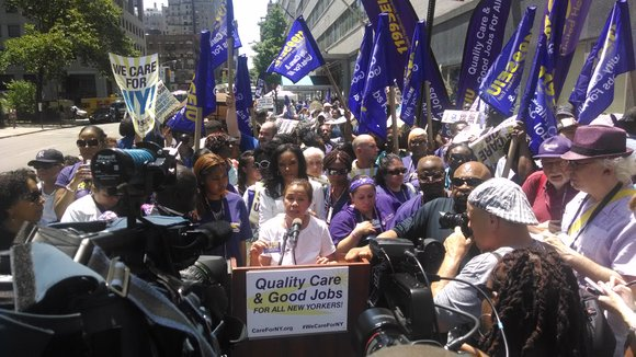 It was a hot day in late spring, but health care workers were turning up the heat on their bosses ...