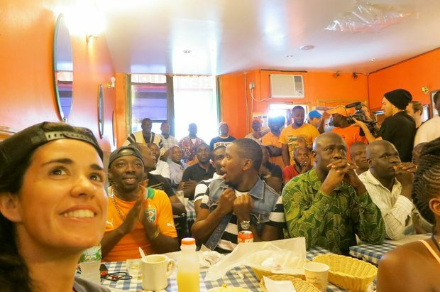 The crowd of New Ivoire cheering after some surprising play against their opponent Colombia.