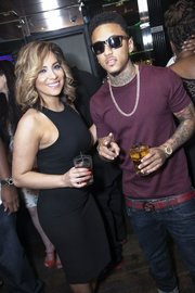 "Yvonne from Team Hennessy Latino and Kirko Bangz at Hennessy V.S, 7Thirteen and Swisha House Records' Houston's ""Money Don't Sleep"" Listening Event"