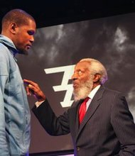 Oklahoma City Thunder forward Kevin Durant (left) stands with comedian and civil rights activist Dick Gregory.