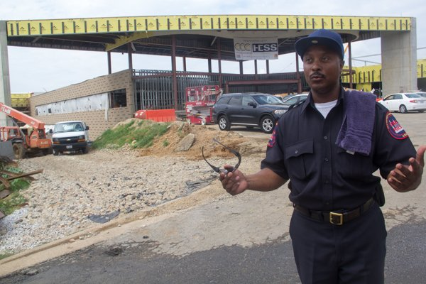 Special police officer Lucas, a resident of Ward 8 works at the site of the new Ballou Sr. High School which is being constructed on the football field of the old school.