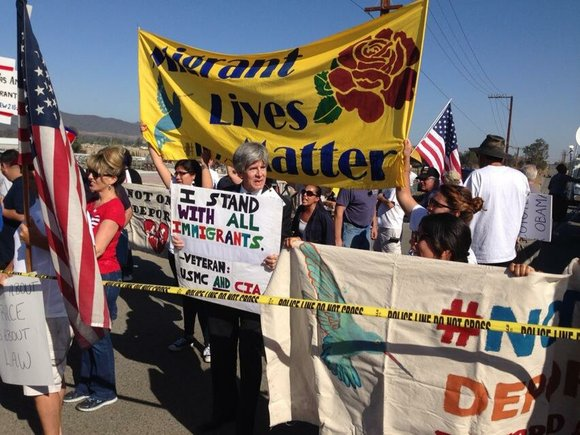 Dozens of demonstrators gathered in Oracle, Arizona, about 100 miles north of the Mexican border, where federal officials were expected ...