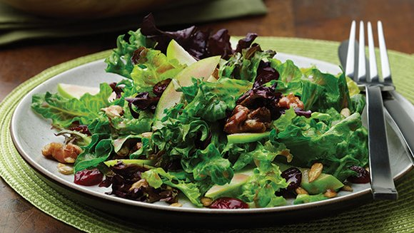 Salads can be more than just lettuce and tomatoes. This salad combines fruit and lettuce with seeds and nuts.