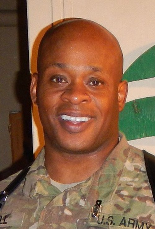 Major (Gerard) Eric Hill, a Boston native and US Army Reserves Officer, was recently honored by the ambassador to Afghanistan ...