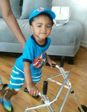 Two-year-old double amputee Kayden Kinckle wows world as he masters his walker
