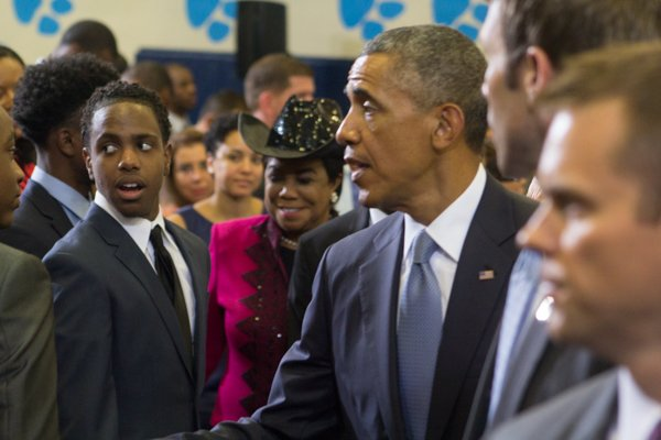 """President Obama greets some of the young men attending the town hall for the White House's """"My Brother's Keeper"""" initiative after his speech.   Rep. Frederica Wilson (D-FL) in the background also attended the event held at Walker Jones Education Center on Monday, July 21."""