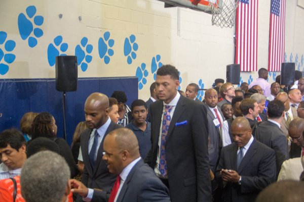 """Isaiah Austin, who missed out on being drafted this year when he was diagnosed with Marfan Syndrome, attends  the town hall for the White House's """"My Brother's Keeper"""" initiative held at Walker Jones Education Center on Monday, July 21."""