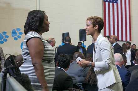 "DCPS Chancellor Kaya Henderson with Education Deputy Chief of Staff Tyra Marianni at the town hall for the White House's ""My Brother's Keeper"" initiative held at Walker Jones Education Center on Monday, July 21."
