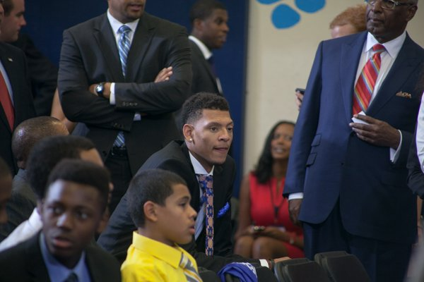 """Isaiah Austin, who missed out on being drafted this year when he was diagnosed with Marfan Syndrome attends the town hall for the White House's initiative, """"My Brother's Keeper,"""" held at Walker Jones Education Center in Northwest on Monday, July 21."""