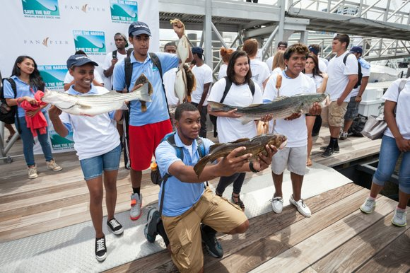 This year's winners of the Fan Pier Celebrity Youth Fishing Tournament included Roza Wineh, 16, of Roxbury, Candido Barros, 19, ...