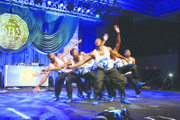 With arms extended in graceful formation, FAMU's Alpha Eta Chapter took home the first-place trophy after a competitive step show last Thursday at the centennial celebration of Phi Beta Sigma Fraternity, Inc.