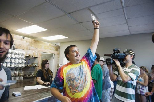Mike Boyer took the day off from work to be the first person to buy legal marijuana in Washington, but unfortunately for him, his employer, a staffing agency in Spokane, saw him on television and asked him to take a drug test. He failed and lost his job. (AP photo)