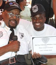 Commander Rocky Robinson and alumni Nicolas Welch, now a fireman