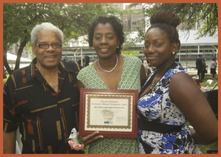 Paul Covington (RHCN CAB) and Denisha Johnson (RHCN CAB and Marjorie Matthews Community Advocate honoree), with daughter, Jasmin Bonilla