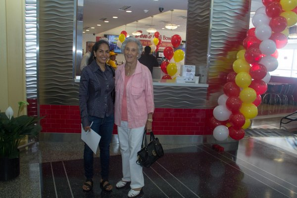 Vida Ali (left) and Virginia Ali (right) at Ben's Chili Bowl's opening of the newest location at National Airport in Arlington, Va., on Wed., July 23.