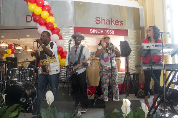 The Chuck Brown Band performs during the opening of Ben's Chili Bowl's newest location at National Airport in Arlington, Va., on Wed., July 23.