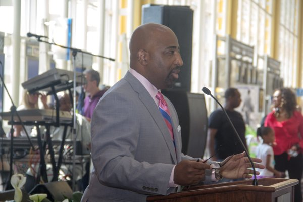 Marketplace Development's Regional Vice President, Clarence LeJeune, speaks during the opening ceremony of Bens' Chili Bowl's newest location at National Airport in Arlington, Va., on Wed., July 23.  Marketplace Development manages all concessions at Reagan National Airport.