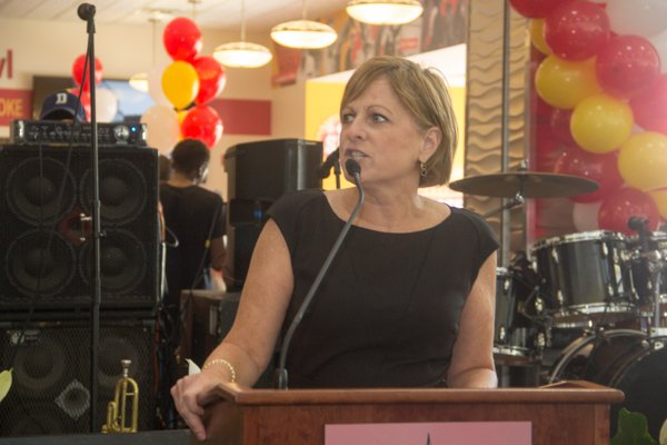 Margaret McKeough, chief operating officer of the Airports Authority speaks during the opening of Ben's Chili Bowl's newest location at National Airport in Arlington, Va., on Wed., July 23.