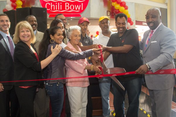Ben's Chili Bowl family cut the ribbon Ben's during the opening of the restaurant's newest location at National Airport in Arlington, Va., on Wed., July 23.