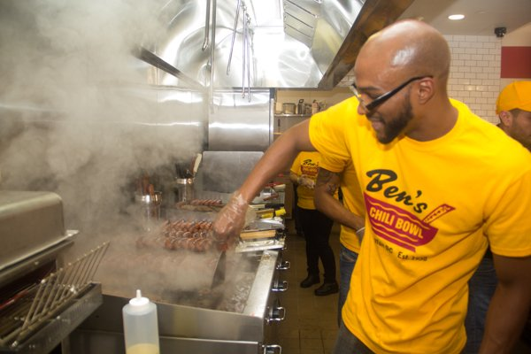 A cook at Ben's Chili Bowl's newest location at National Airport in Arlington, Va., on Wed., July 23.
